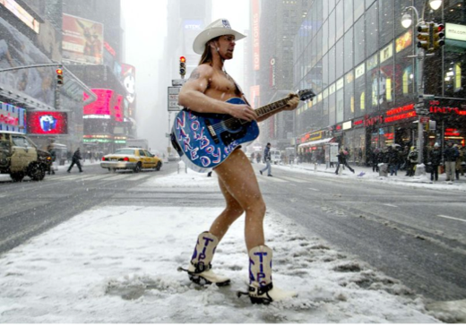 Famous Naked Cowboy wearing designer cowboy boots from NYC