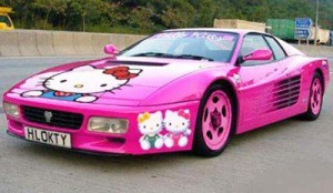 hello kitty sticker on a pink car